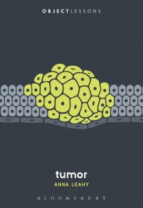 book cover for tumor; graphic of yellow tumor against black background